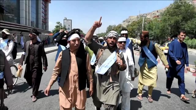 dozens of peace protesters arrive in kabul after walking hundreds of kilometres across war battered afghanistan as the taliban ended an unprecedented... - ceasefire stock videos & royalty-free footage