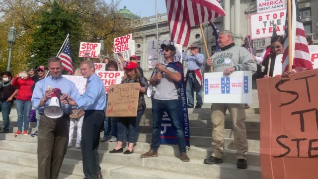 dozens of people calling for stopping the vote count in pennsylvania due to alleged fraud against president donald trump gather on the steps of the... - fraud stock videos & royalty-free footage