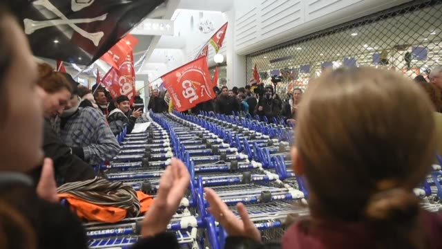 dozens of people demonstrate inside the atlantis shopping centre in saint-herblain near nantes against the french government's pension reform project - nantes stock videos & royalty-free footage
