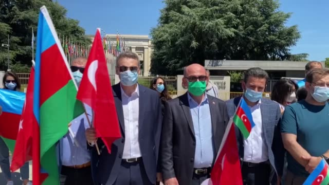 dozens of people from azerbaijani community in switzerland took to the streets on sunday to protest against armenia's cross-border attacks on... - dozen stock videos & royalty-free footage