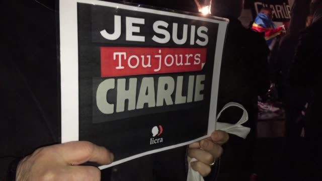 vídeos de stock, filmes e b-roll de dozens of people gather at place de la republique in paris on the second anniversary of the terror attack that claimed the lives of twelve people at... - sátira