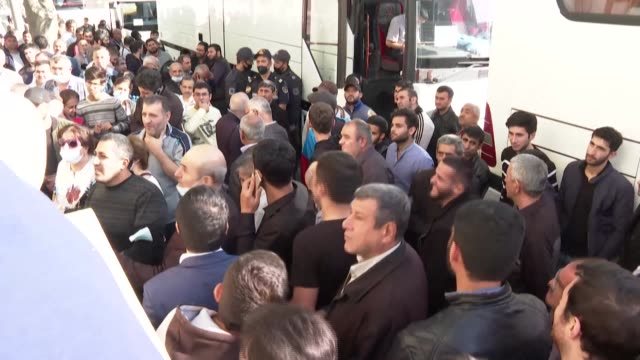 dozens of people gather in front of a military recruitment centre in baku after azerbaijan declares martial law and a curfew in the capital and... - military recruit stock videos & royalty-free footage