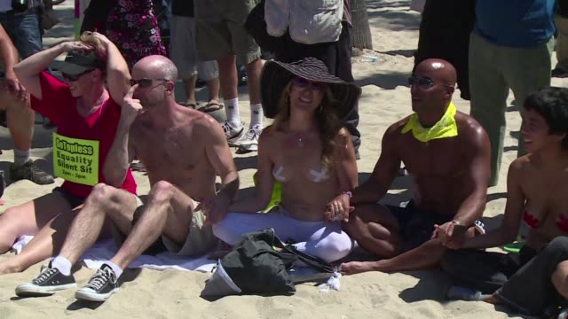 Dozens of people join Go Topless in Los Angeles to protest against the ban on women being topless on California beaches
