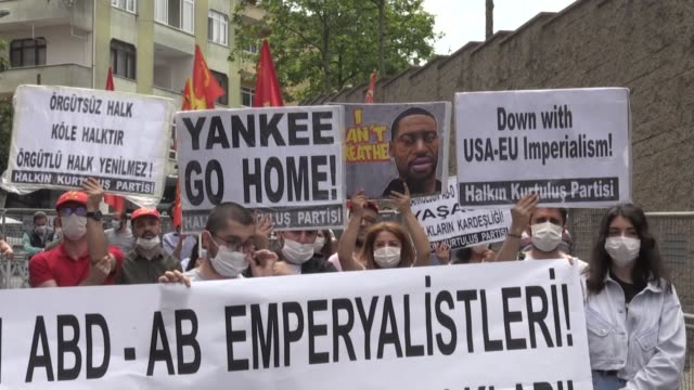 dozens of people on sunday staged a peaceful demonstration outside the us embassy in turkey's istanbul in support of the black lives matter movement... - i can't breathe stock videos & royalty-free footage