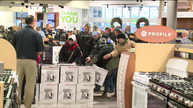 dozens of people were lined up for the chance to get $400 kitchen aid mixers that were on sale for $100 at nebraska furniture mart in kansas city,... - black friday stock videos & royalty-free footage