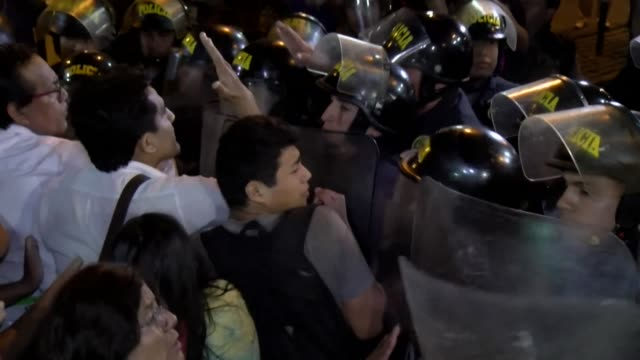 dozens of protesters clash with police in peru following the decision by the country's constitutional court to order the release of opposition leader... - releasing stock videos & royalty-free footage