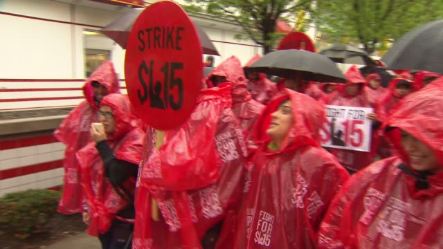 Dozens of protesters gathered outside of Chicago's Rock 'n' Roll McDonald's demanding higher wages on May 15 2014