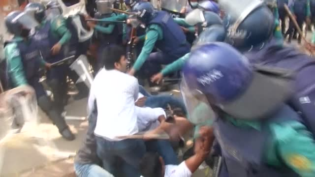 dozens of protesters were injured as new clashes erupted between the bangladeshi police and protesters, in a third day of protests sparked by the... - critic stock videos & royalty-free footage