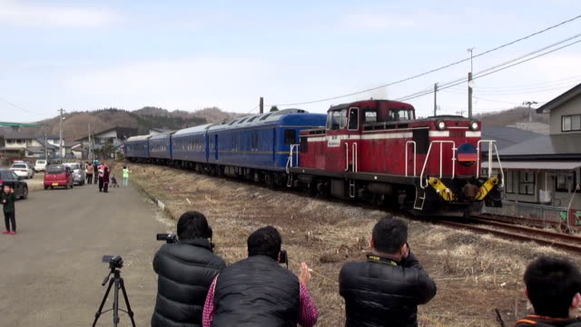 dozens of railway fans gathered in northern japan town of kosaka akita prefecture on april 10 to see a retired sleeper train that ran again only for... - tourist train stock videos and b-roll footage