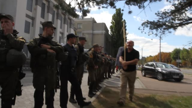 Dozens of rightwing activists block the entrance to Russia's embassy in Ukrainian capital where a polling station has been set up for Russian...