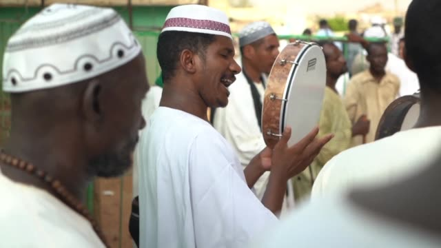 dozens of sudanese gather at the tomb of 19th century sufi leader sheikh hamed alnil to dance sing and pray together - praying stock videos & royalty-free footage