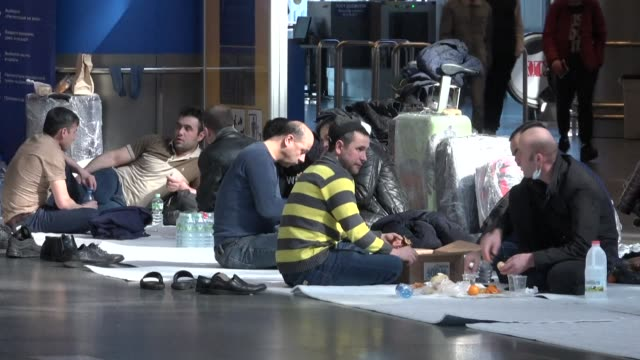 dozens of tajiks and uzbeks are desperate to return home after spending endless nights on the tiled floor of the departure hall of moscow's vnukovo... - moscow russia stock videos & royalty-free footage