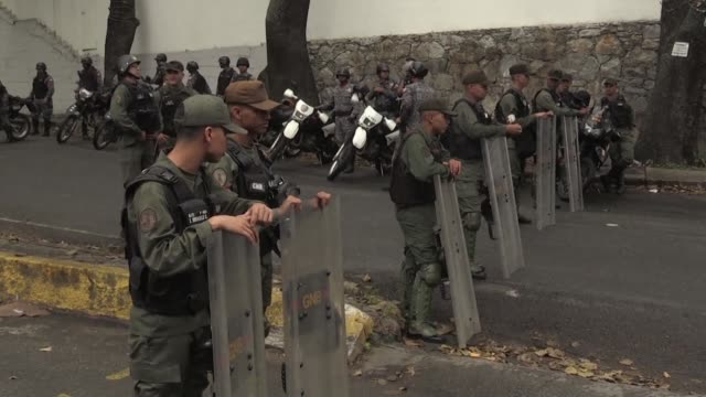 Dozens of Venezuelan soldiers ringed a Caracas morgue Wednesday where the body of dissident former police officer Oscar Perez and six others were...