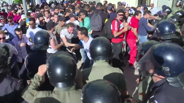 dozens of visually impaired unemployed graduates demonstrated outside rabat's ministry of family on saturday to demand jobs and denounce the death of... - visual impairment stock videos & royalty-free footage