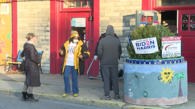 dozens of voters wait to cast their ballot at a polling station in easton, in the swing state of pennsylvania. donald trump won that state by 44,000... - cast member stock videos & royalty-free footage