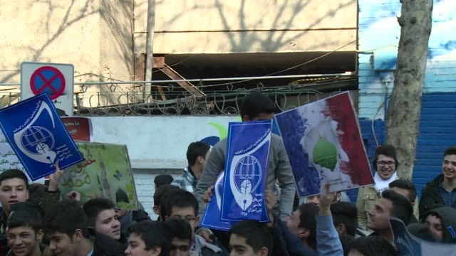 vídeos de stock, filmes e b-roll de dozens of young iranian students took part on tuesday in a protest against the printing of satirical sketches of the prophet mohammed by french... - sátira