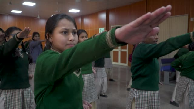 dozens of young women attend a selfdefense class in delhi aiming to equip themselves for the future in 21stcentury india a country which retains a... - self defence stock videos & royalty-free footage