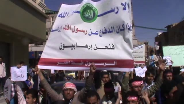 dozens protested in front of the french membassy in sanaa after the french satirical paper published a cartoon of prophet mohammad on its front page - prophet stock videos and b-roll footage