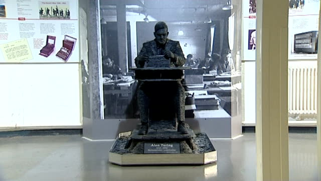 Dr Alan Turing given royal pardon T14121219 Buckinghamshire Bletchley Park Various views of statue of Turing working with an enigma machine Building...
