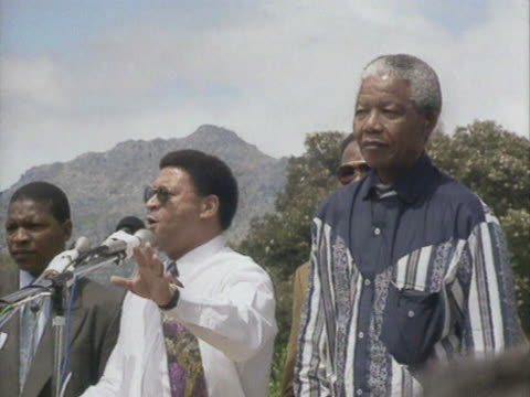 Dr Allan Boesak standing next to Nelson Mandela makes a speech outside Victor Verster Prison stating that never again will their children go to prison