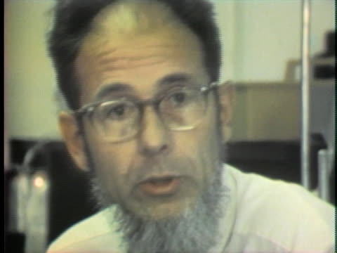 dr. alvin goldstein describes research that is attempting to find the chemical processes that cause mental illness. - schizophrenia stock videos & royalty-free footage
