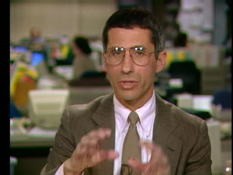 """dr. anthony fauci says that we are in an """"evolution in the development of treatment"""" of aids during an interview in 1991. - retrovirus video stock e b–roll"""