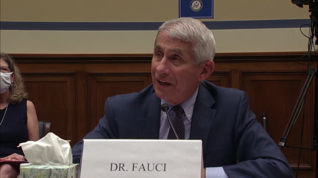 dr. anthony fauci speaks of optimism on coronavirus vaccine development during his remarks at a house hearing in washington d.c. - healthcare and medicine or illness or food and drink or fitness or exercise or wellbeing stock videos & royalty-free footage