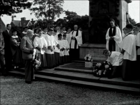 dr barnardo's homes memorial service england london barkingside ext wide shot dr barnardo home / sign for 'the village homes dr barnardo's homes' /... - choir stock videos & royalty-free footage