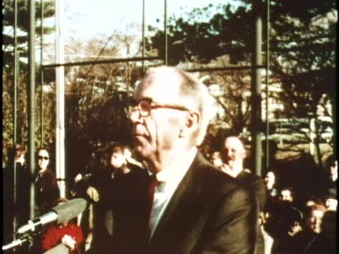 dr benjamin spock gives a speech at an antiwar demonstration in washington dc - friedensdemonstration stock-videos und b-roll-filmmaterial