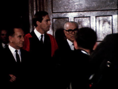 dr christiaan barnard wearing a red robe enters a formal reception room in cape town to be presented with the freedom of the city may 1968 - formal reception stock videos and b-roll footage