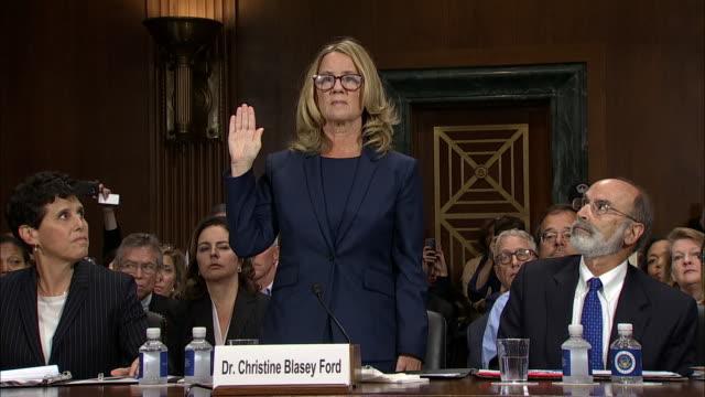 dr. christine blasey ford is sworn in by senator charles grassley at the senate hearing on september 27, 2018 in washington d.c. - 宣誓点の映像素材/bロール
