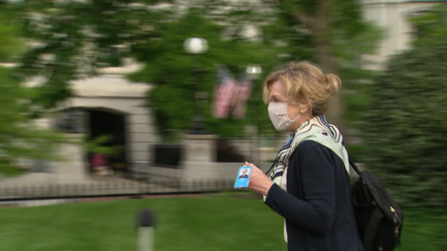 dr. deborah birx walks by reporters outside the white house wearing a face mask during the coronavirus pandemic. - healthcare and medicine or illness or food and drink or fitness or exercise or wellbeing stock videos & royalty-free footage