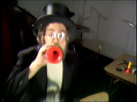 Dr Demento talks about one of his favorite records and plays it on his Victrola record player and plays records while ringing bells and playing toy...
