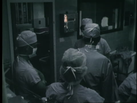 dr. denton cooley and his team finish a surgery and leave an operating room. - operation stock videos & royalty-free footage