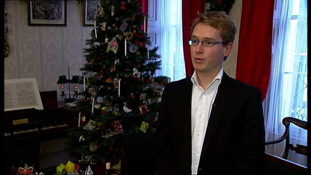 dr florian schweizer opening book cupboard close shot books by charles dickens dr florian schweizer interview sot woman browsing display in museum... - charles dickens stock videos and b-roll footage