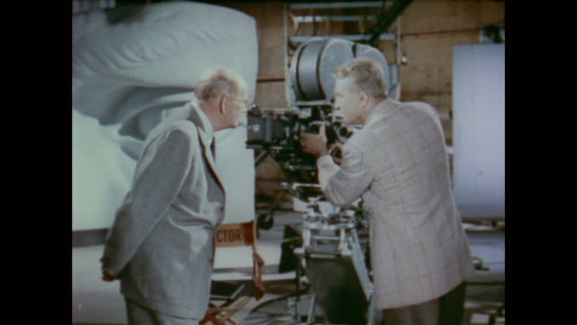 1958 dr. frank baxter explains to dr. wilder penfield how a movie camera works focusing on the processing of light - film camera stock videos & royalty-free footage