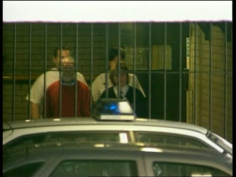 charged with two more murders bnat sue england manchester tameside magistrates court ext ls dr harold shipman from door with guards to prison van as... - 脱獄する点の映像素材/bロール