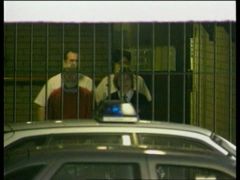 charged with two more murders cc4n u'lay itn england tameside magistrates court dr harold shipman from door with guards to prison van as ducks to... - 脱獄する点の映像素材/bロール