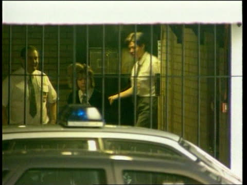 new charges brought cC4N U'LAY ENGLAND Manchester EXT Dr Harold Shipman handcuffed to prison officer across to prison van