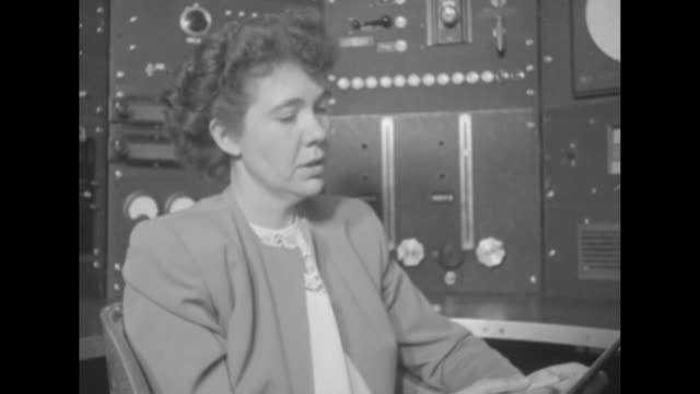cu dr jane long sitting in front of control panel talking to dr david long pan across to david / jane sitting in front of control panel looking at... - household fixture stock videos and b-roll footage