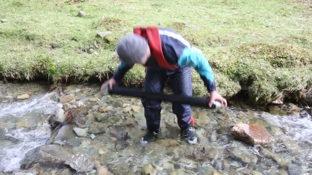 dr jeff warburton of durham university empties a sediment trap from a river entering buttermere lake in the lake district national park as part of a... - physical geography stock videos & royalty-free footage