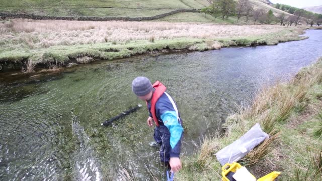 dr jeff warburton of durham university empties a sediment trap from a river entering buttermere lake in the lake district national park as part of a... - erodiert stock-videos und b-roll-filmmaterial