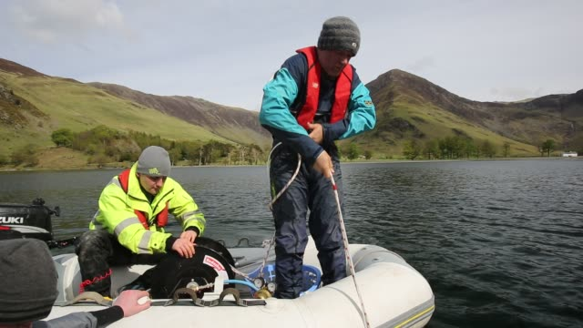 dr jeff warburton of durham university preparing to take sediment cores from the bottom of buttermere lake in the lake district national park as part... - study stock videos & royalty-free footage