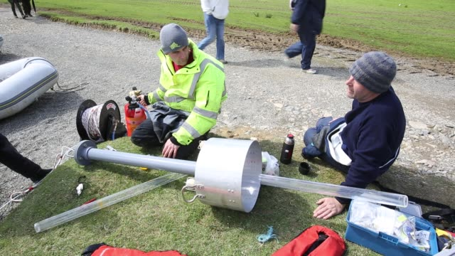 dr jeff warburton of durham university preparing to take sediment cores from the bottom of buttermere lake in the lake district national park as part... - sand stock videos & royalty-free footage