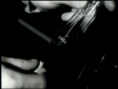 Dr Lee DeForest w/ radio tube in his laboratory Bell Lab engineers Donald McKinsey Edward Winter in lab working men working w/ Vitaphone machine...