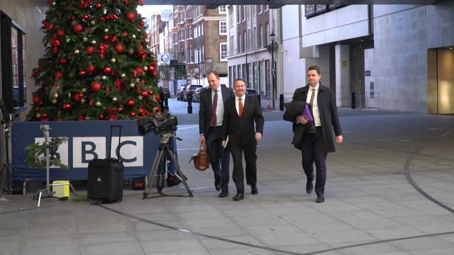 dr liam fox walking into bbc new broadcasting house for appearance on andrew marr - liam fox politician stock videos and b-roll footage