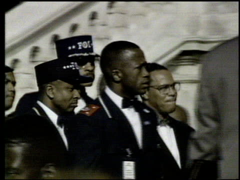 / dr louis farrakhan, nation of islam leader, speaking to crowds at million man march / crowd views. louis farrakhan giving speech at million man... - 1995 bildbanksvideor och videomaterial från bakom kulisserna