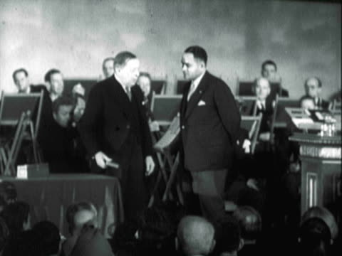dr ralph bunche being presented the nobel peace prize at ceremony in oslo norway / dr ralph bunche alighting stage shaking hands / ralph bunche... - respekt bildbanksvideor och videomaterial från bakom kulisserna