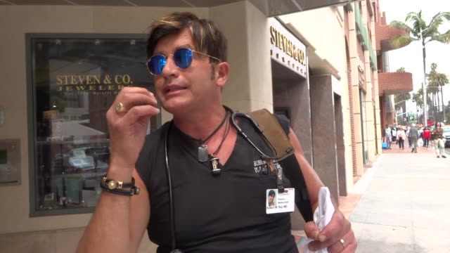 interview dr robert rey talks about if caffeine is bad for your health while shopping in beverly hills in celebrity sightings in los angeles - caffeine stock videos & royalty-free footage