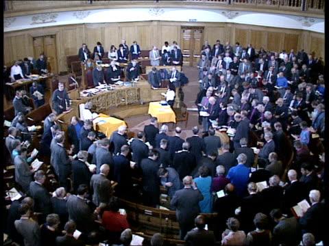 dr robert runcie enters, delegates stand, runcie says prayers/ cutaways delegs listening to prayers/ runcie speech, stenographer, clerics listening.... - robert runcie stock videos & royalty-free footage